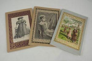 Notizhefte, deren Covers mit schönen Bildern und Texten von alten Büchern verziert sind